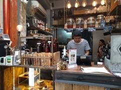 selfmade sirups, waiter in stripes, fancy espresso machine