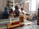 rainbow cheesecake on a wooden plate, durian milkshake in a jar